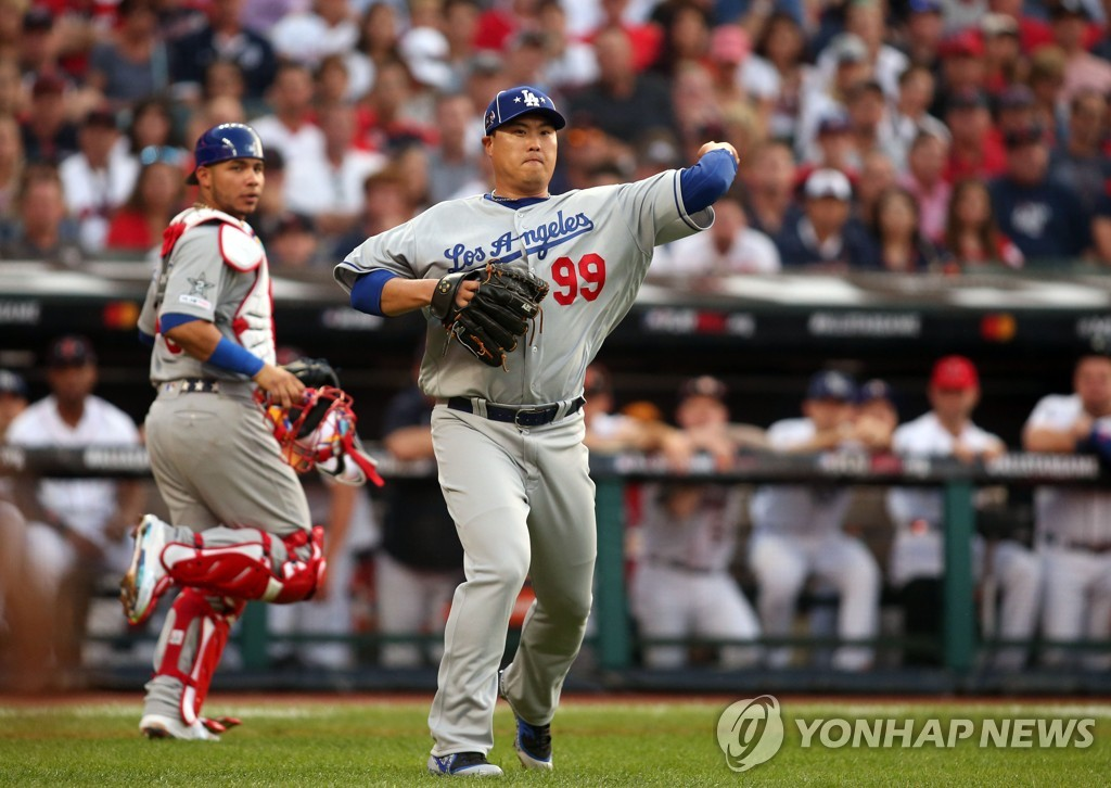 In this Reuters photo via USA Today, National League starter Ryu Hyun-jin throws to first base following a grounder by DJ LeMahieu of the American League in the bottom of the first inning of the Major League Baseball All-Star Game at Progressive Field in Cleveland on July 9, 2019. (Yonhap)
