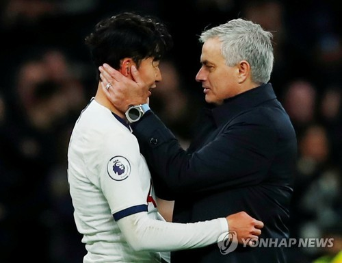 In this Reuters photo, Tottenham Hotspur head coach Jose Mourinho (R) congratulates Son Heung-min after the club's 5-0 victory over Burnley in the Premier League match at Tottenham Hotspur Stadium in London on Dec. 7, 2019. (Yonhap)