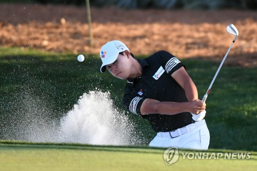 In this USA Today Sports photo via Reuters, Kim Si-woo of South Korea hits a bunker shot at the ninth hole during the first round of The Players Championship at TPC Sawgrass in Ponte Vedra Beach, Florida, on March 12, 2020. (Yonhap)