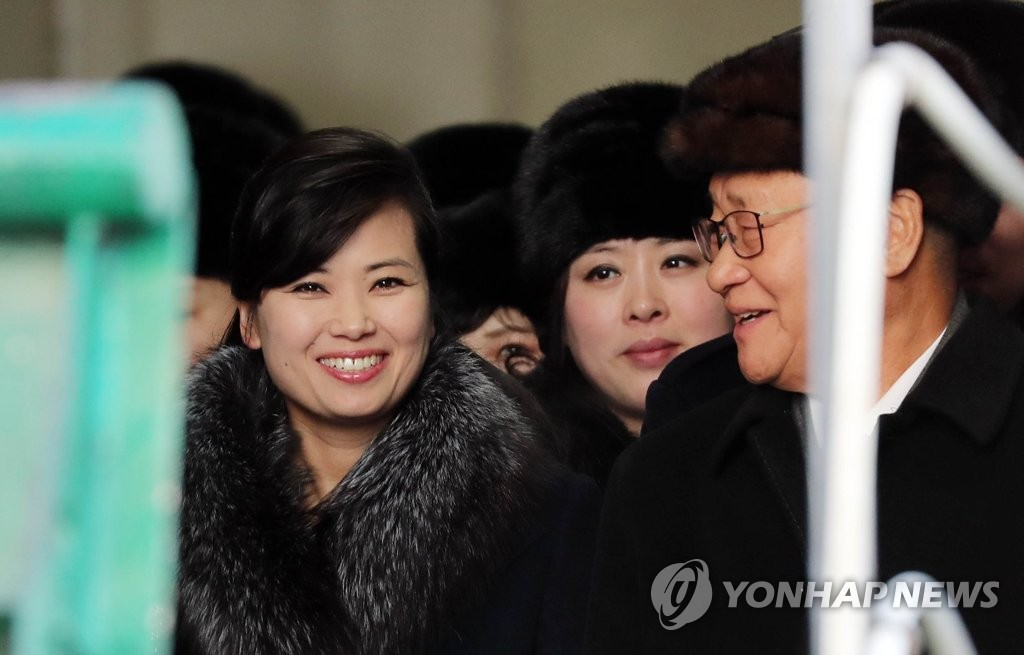 In this file photo taken on Feb. 7, 2018, Hyon Song-wol (L), the head of the all-female Moranbong Band and leader of the Samjiyon art troupe, disembarks from the North Korean ship Mangyongbong-92 after it docked in Donghae, Gangwon Province. (Yonhap)