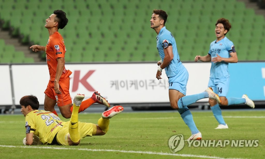 In this file photo, taken Aug. 8, 2018, Daegu FC forward Cesinha (2nd from R) scores a goal against Yangpyeong FC in a Korea Football Association Cup round of 16 match at Daegu Stadium in Daegu. (Yonhap)