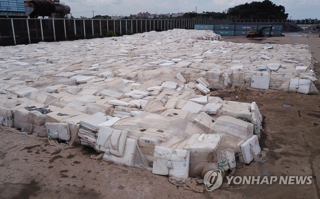 This photo shows an open-air yard in Dangjin, 120 kilometers south of Seoul, full of collected mattresses on Sept. 7, 2018. (Yonhap)