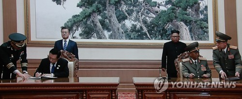 Moon: Two Koreas may exchange military information, observe each other's drills