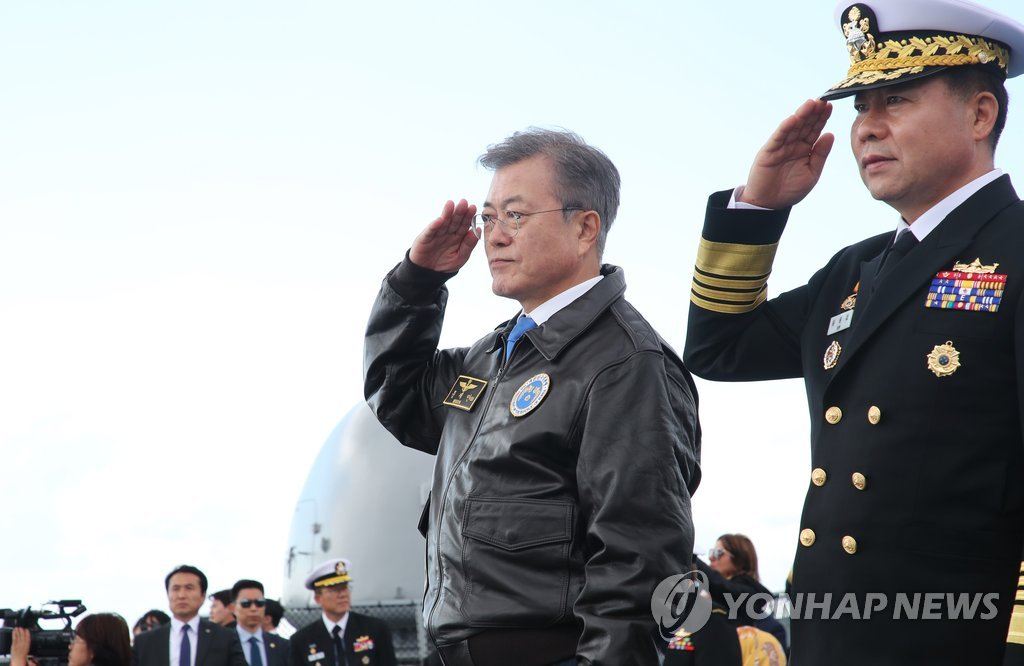 South Korean President Moon Jae-in (2nd from R) salutes while inspecting naval vessels from 13 countries at the International Fleet Review held in waters off his country's southern island of Jeju on Oct. 11, 2018. (Yonhap)