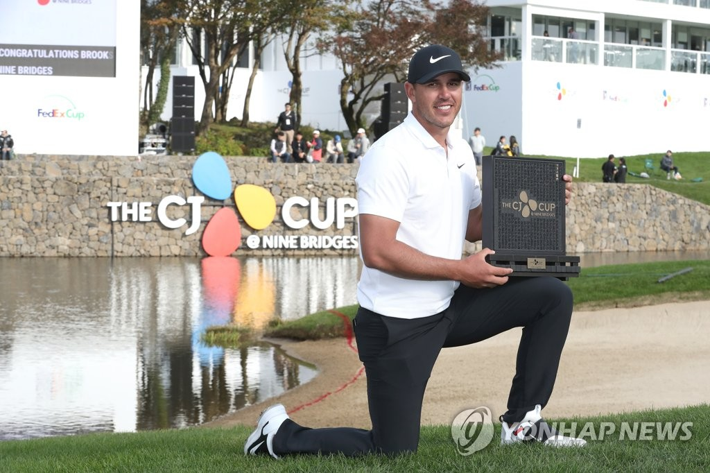 In this file photo from Oct. 21, 2018, Brooks Koepka of the United States poses with the champion's trophy after winning the PGA Tour's CJ Cup @ Nine Bridges at the Club at Nine Bridges in Seogwipo, Jeju Island. (Yonhap)