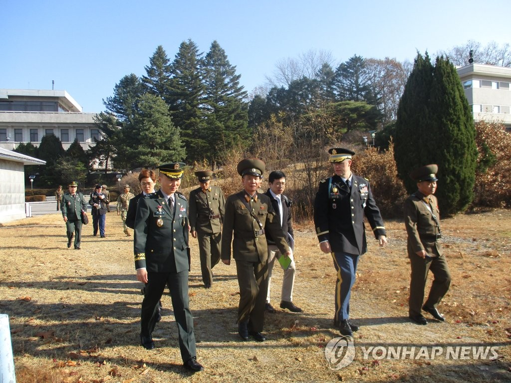 This photo provided by South Korea's defense ministry shows military officials from South and North Korea and the United Nations Command (UNC) inspecting the Joint Security Area (JSA) at the border truce village of Panmunjom on Nov. 13, 2018. (Yonhap)