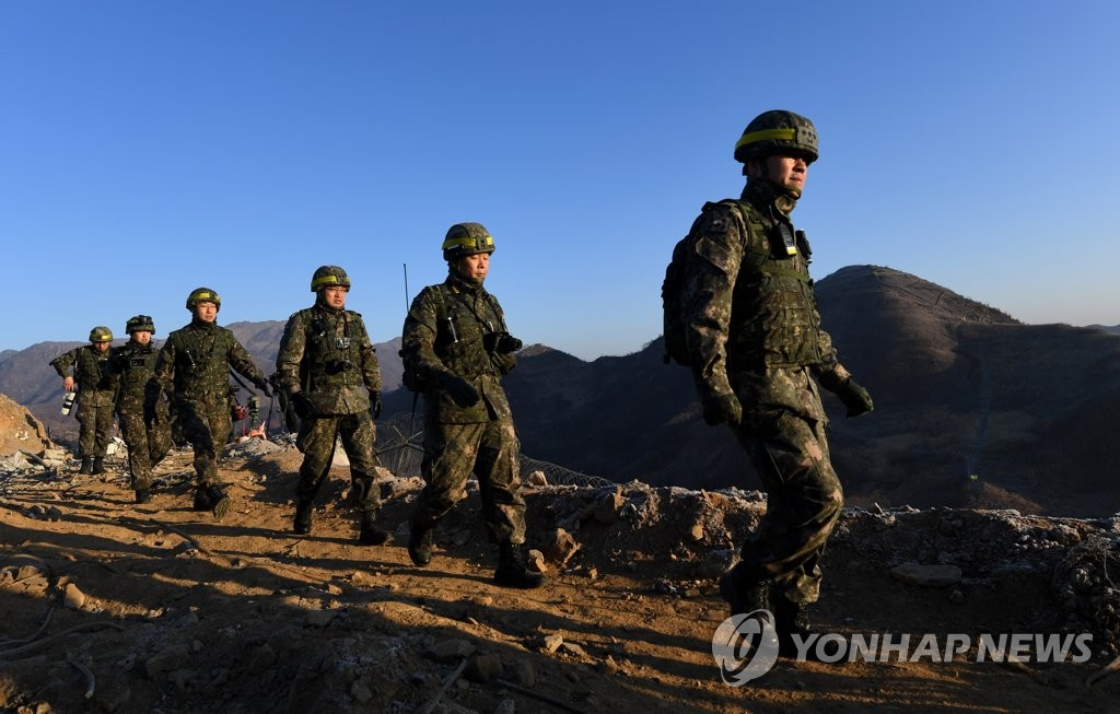 South Korean troops walk toward a North Korean guard post in the Demilitarized Zone to verify its withdrawal on Dec. 12, 2018, in this photo provided by the Joint Press Corps. (Yonhap)