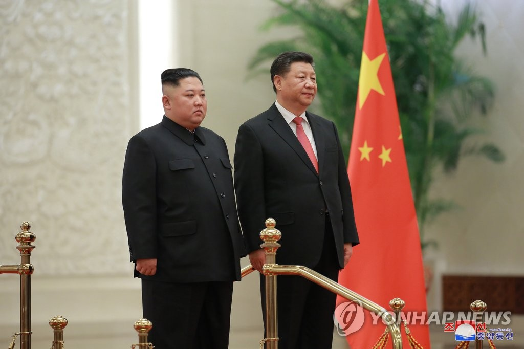 This photo, published by the North's Korean Central News Agency on Jan. 10, 2019, shows North Korean leader Kim Jong-un (L) and Chinese President Xi Jinping in Beijing on Jan. 8. (For Use Only in the Republic of Korea. No Redistribution.) (Yonhap)