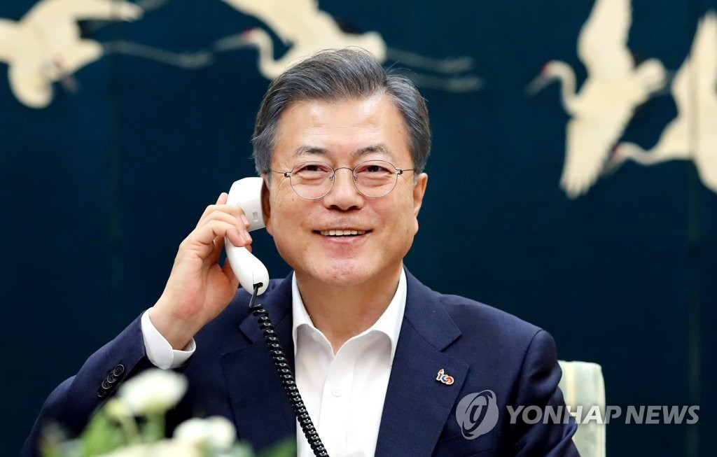 In this photo provided by South Korea's presidential office Cheong Wa Dae, South Korean President Moon Jae-in holds a telephone conversation with U.S. President Donald Trump on Feb. 19, 2019. (Yonhap)