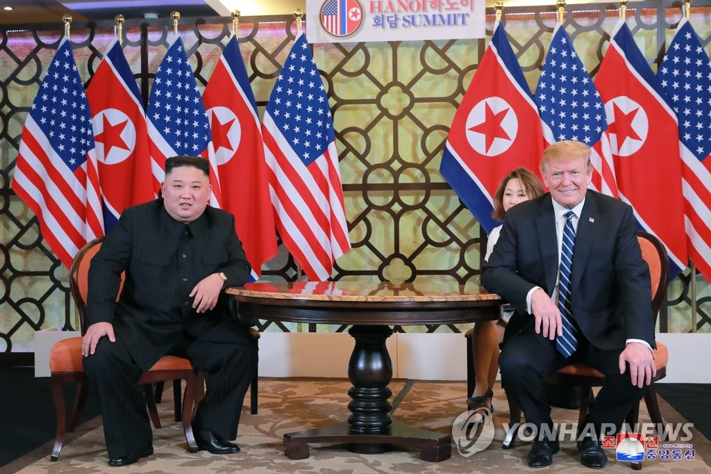 North Korean leader Kim Jong-un (L) and U.S. President Donald Trump hold talks at the Sofitel Legend Metropole hotel in Hanoi on Feb. 28, 2019, in this photo carried by the North's official Korean Central News Agency the next day. (For Use Only in the Republic of Korea. No Redistribution) (Yonhap)
