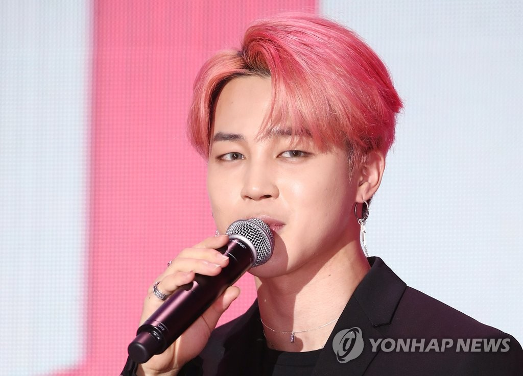 """This file photo shows Jimin, a member of South Korean boy group BTS, at a showcase for the group's new album """"Map of the Soul: Persona"""" in Seoul on April 17, 2019. (Yonhap)"""