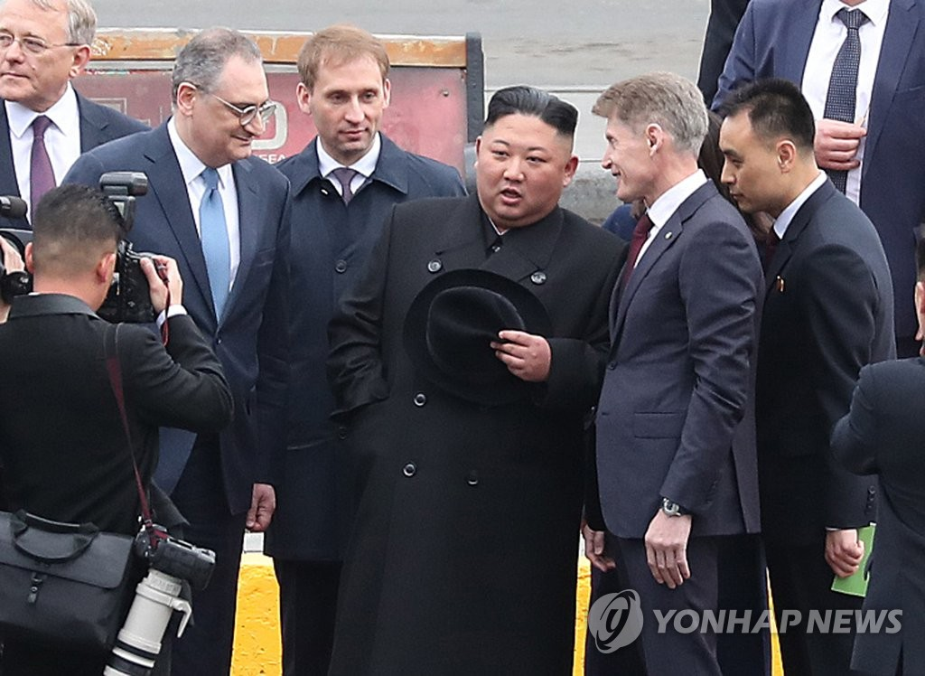 North Korean leader Kim Jong-un (3rd from R) talks with Russian officials upon arriving at a station in Russia's Far Eastern city of Vladivostok on April 24, 2019. (Yonhap)