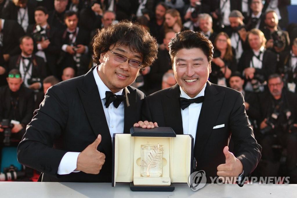 칸의 남자 봉준호 감독과 배우 송강호