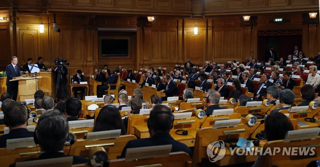 Members of the Swedish parliament listen to South Korean President Moon Jae-in's speech on the Korean peace process at the Parliament House in Stockholm on June 14, 2019. (Yonhap)