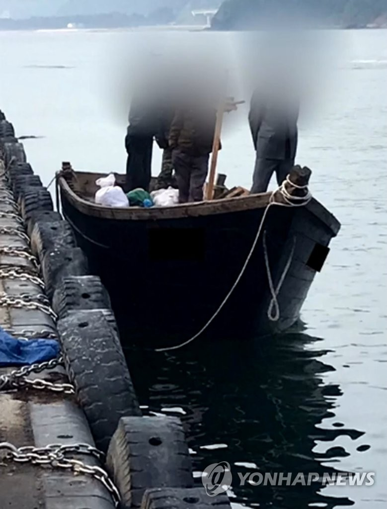 In this photo provided by public broadcaster KBS, a North Korean fishing boat carrying four people is anchored at the port of Samcheok, Gangwon Province, on June 15, 2019. (PHOTO NOT FOR SALE) (Yonhap)