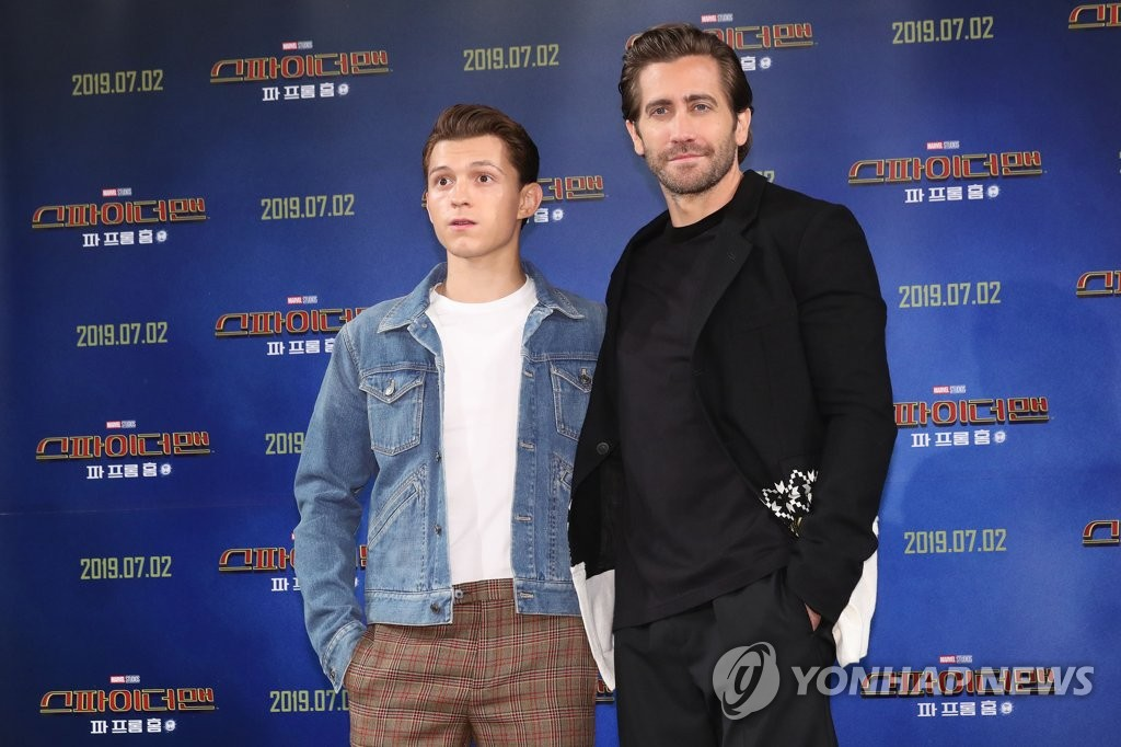 "Tom Holland (L) and Jake Gyllenhaal of ""Spider-Man: Far From Home"" pose during a press conference in Seoul on July 1, 2019. (Yonhap)"