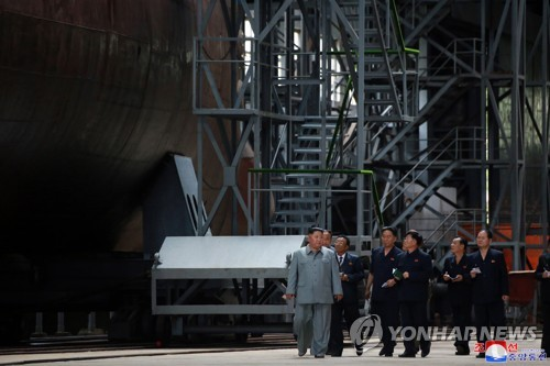 N.K. leader inspects new submarine to be deployed in East Sea: state media