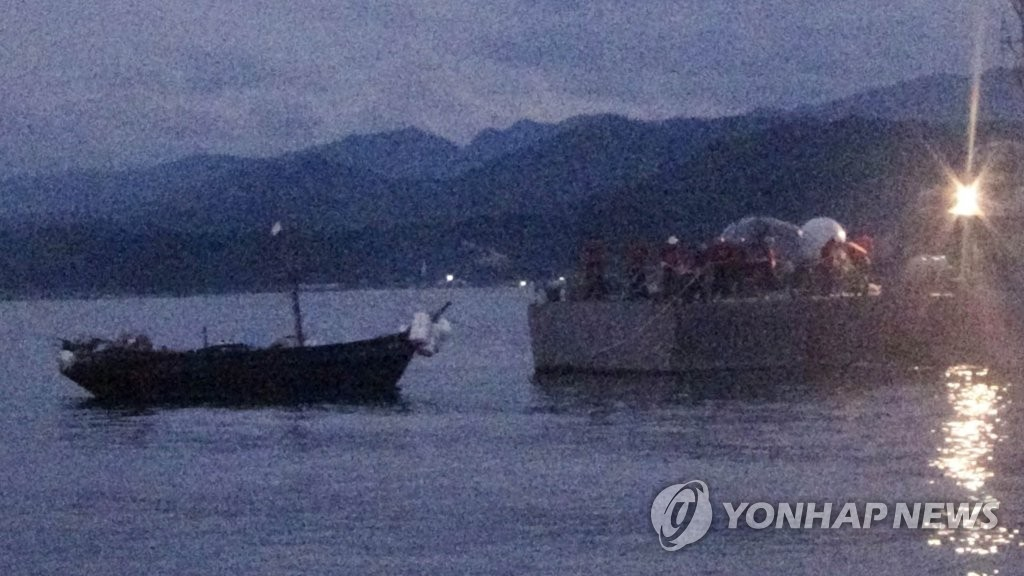 A North Korean wooden boat is towed into a South Korean port on July 28, 2019, in this photo provided by the Joint Chiefs of Staff. (PHOTO NOT FOR SALE) (Yonhap)