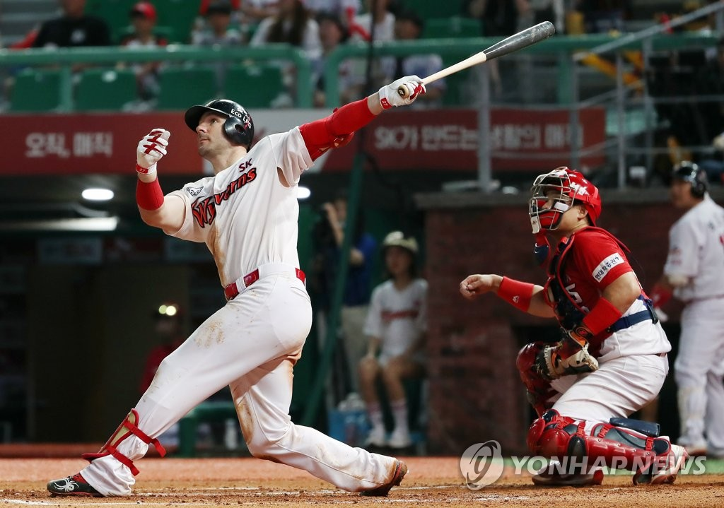 In this file photo from Aug. 1, 2019, Jamie Romak of the SK Wyverns hits a solo home run against the Kia Tigers in the bottom of the seventh inning of a Korea Baseball Organization regular season game at SK Happy Dream Park in Incheon, 40 kilometers west of Seoul. (Yonhap)