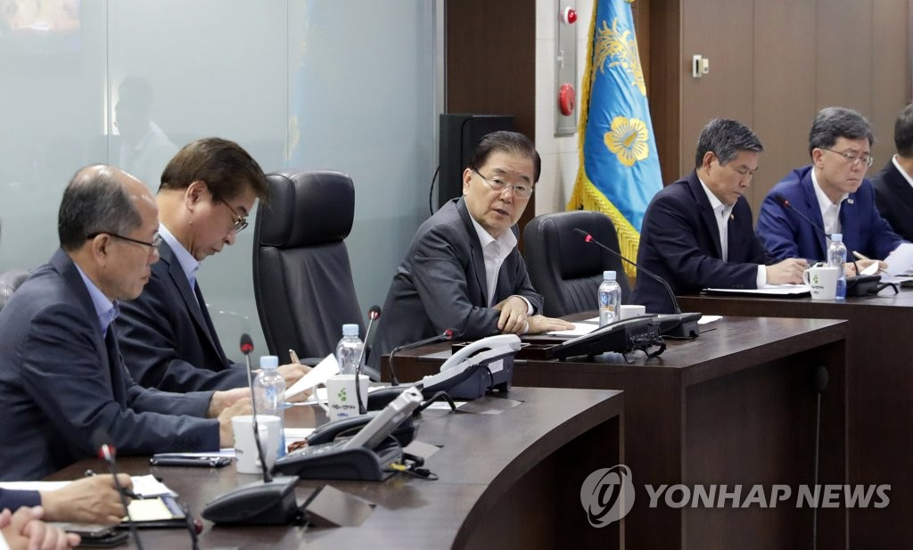 Chung Eui-yong (3rd from L), head of the presidential national security office, presides over a meeting of top security officials at Cheong Wa Dae in Seoul on Aug. 2, 2019, following North Korea's launch of two projectiles, in this photo provided by Cheong Wa Dae. (PHOTO NOT FOR SALE) (Yonhap)
