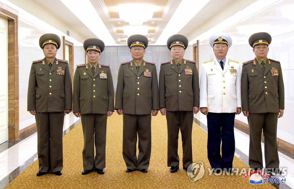 A North Korean military delegation, led by Kim Su-gil (3rd from L), the director of the General Political Bureau of the North's Korean People's Army, poses in this photo released on Aug. 17, 2019, by the North's Korean Central News Agency. (For Use Only in the Republic of Korea. No Redistribution) (Yonhap)