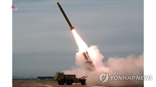 N. Korea tests new super-large multiple rocket launcher
