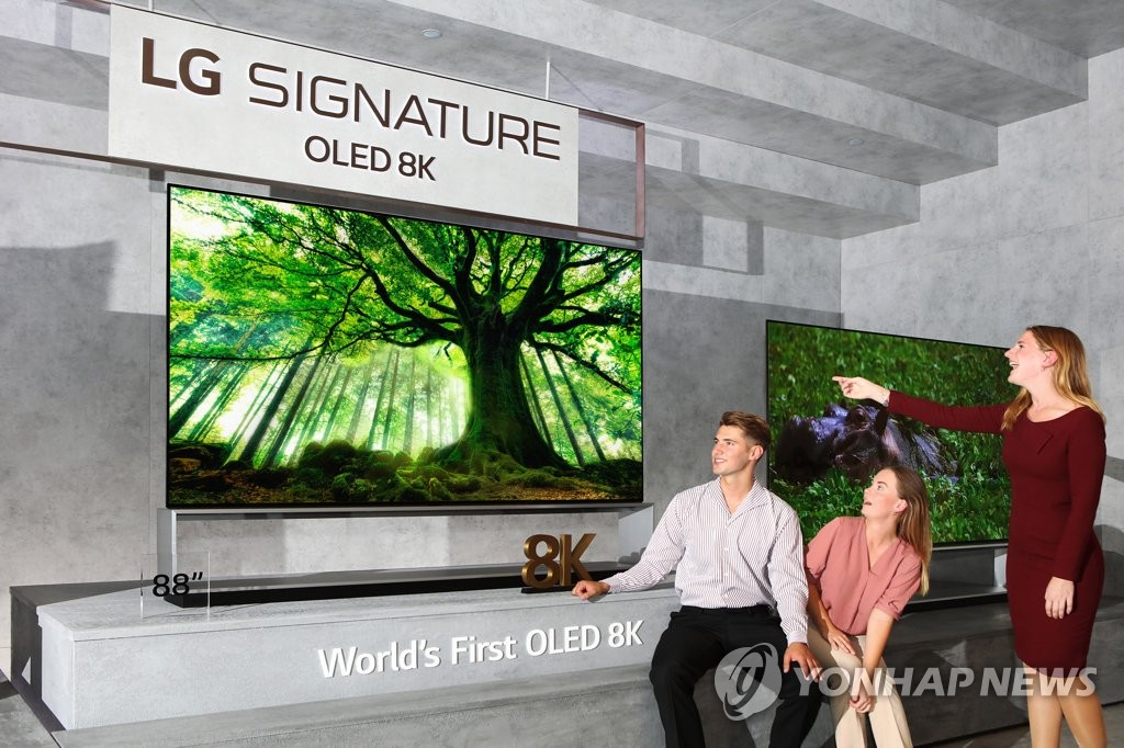 Models pose with LG Electronics Inc.'s 8K OLED TV in this photo provided by the company on Sept. 3, 2019. (PHOTO NOT FOR SALE) (Yonhap)