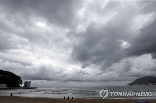 Dark clouds cast over Busan