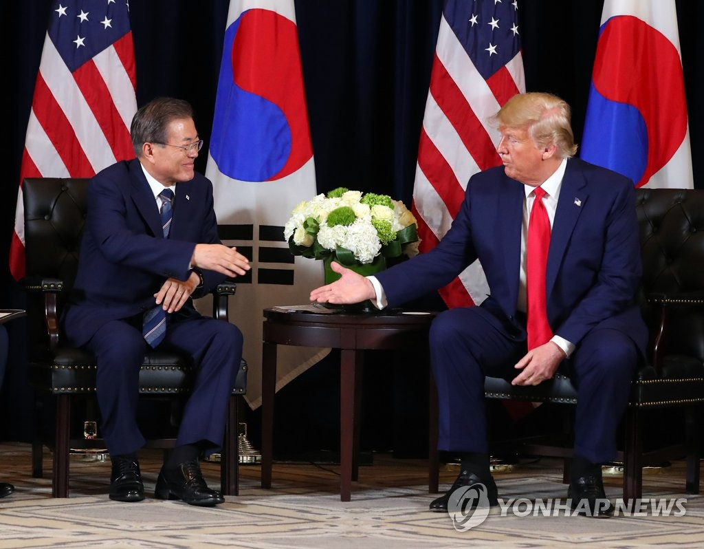 This file photo, dated Sept. 24, 2019, shows South Korean President Moon Jae-in (L) meeting with U.S. President Donald Trump in New York. (Yonhap)
