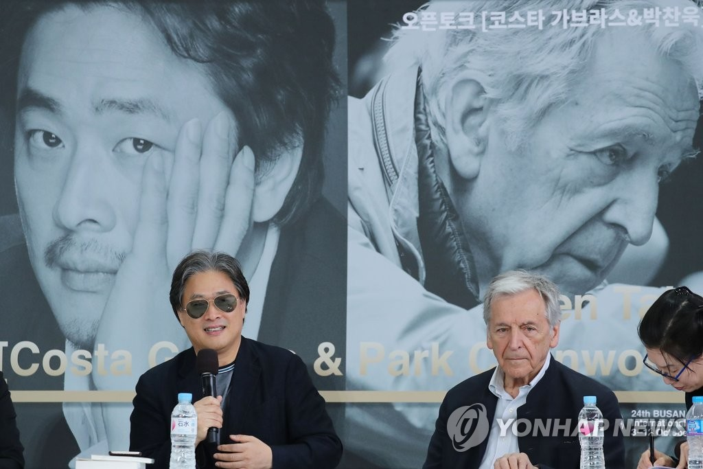 South Korean director Park Chan-wook (L) speaks at an open talk with French filmmaker Costa Gavras (R) during the Busan International Film Festival at the Busan Cinema Center in Busan on Oct. 6, 2019. (Yonhap)