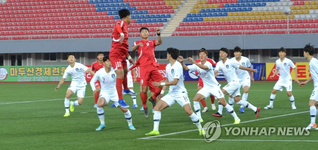 This photo, provided by the Asian Football Confederation, South Korea (in white) and North Korea (in red) in action in their Group H match in the second round of the Asian qualification for the 2022 FIFA World Cup at Kim Il-sung Stadium in Pyongyang on Oct. 15, 2019. (PHOTO NOT FOR SALE) (Yonhap)