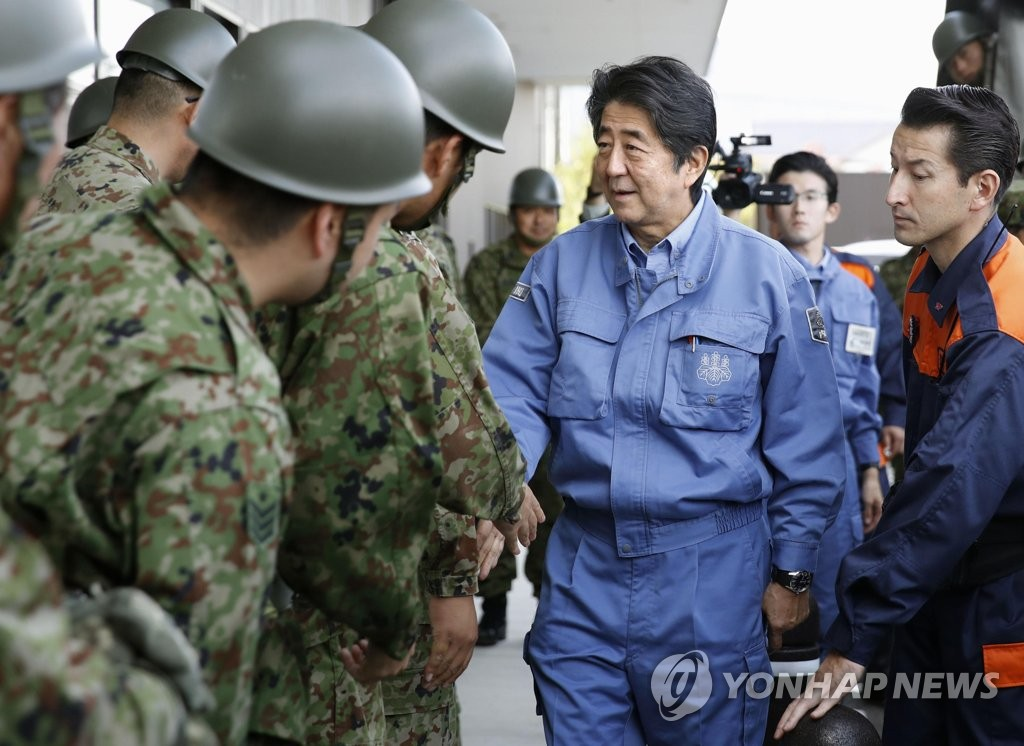 In this Kyodo News photo, dated Oct. 17, 2019, Japanese Prime Minister Shinzo Abe greets the country's Self-Defense Forces soldiers in Fukushima, Japan. (Yonhap)