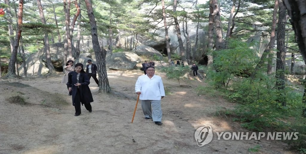 In this image captured from the North's Korean Central TV Broadcasting Station on Oct. 23, 2019, North Korean leader Kim Jong-un tours the Mount Kumgang resort on the country's east coast. (For Use Only in the Republic of Korea. No Redistribution) (Yonhap)