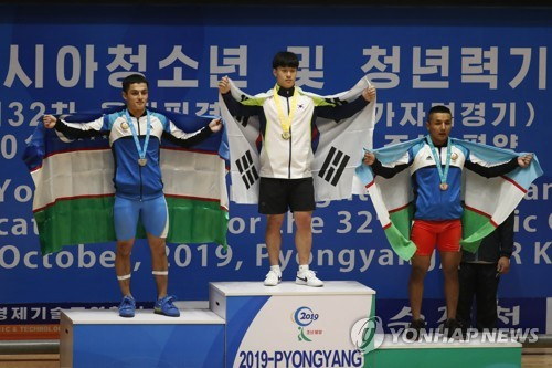 Gold at Pyongyang weightlifting contest