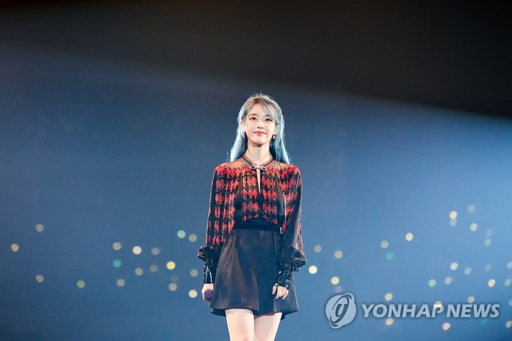 This file photo, provided by Kakao M Corp. on Dec. 31, 2019, shows K-pop songstress IU during her Asia tour. (PHOTO NOT FOR SALE) (Yonhap)