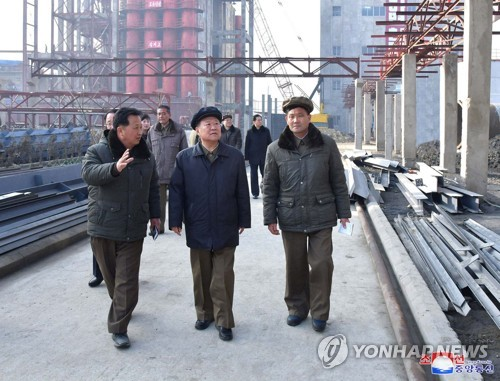 N.K. No. 2 leader inspects factory