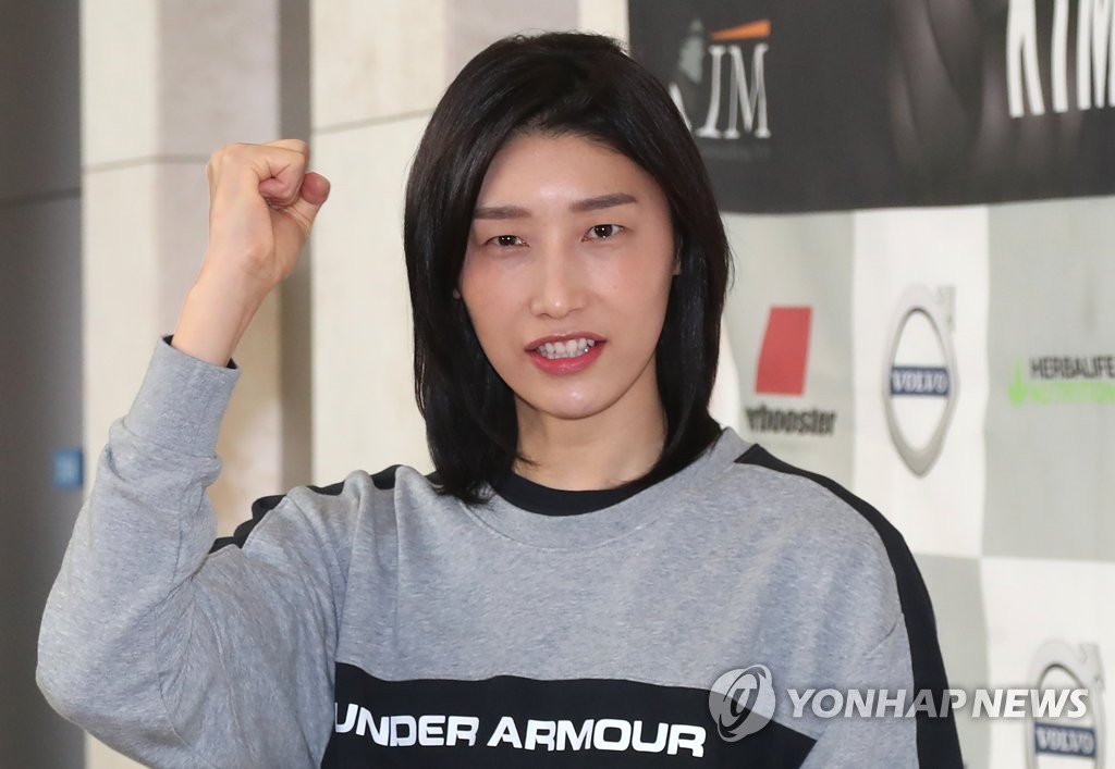 In this file photo from Feb. 20, 2020, South Korean volleyball player Kim Yeon-koung poses for photos at Incheon International Airport, west of Seoul, before departing for Turkey. (Yonhap)