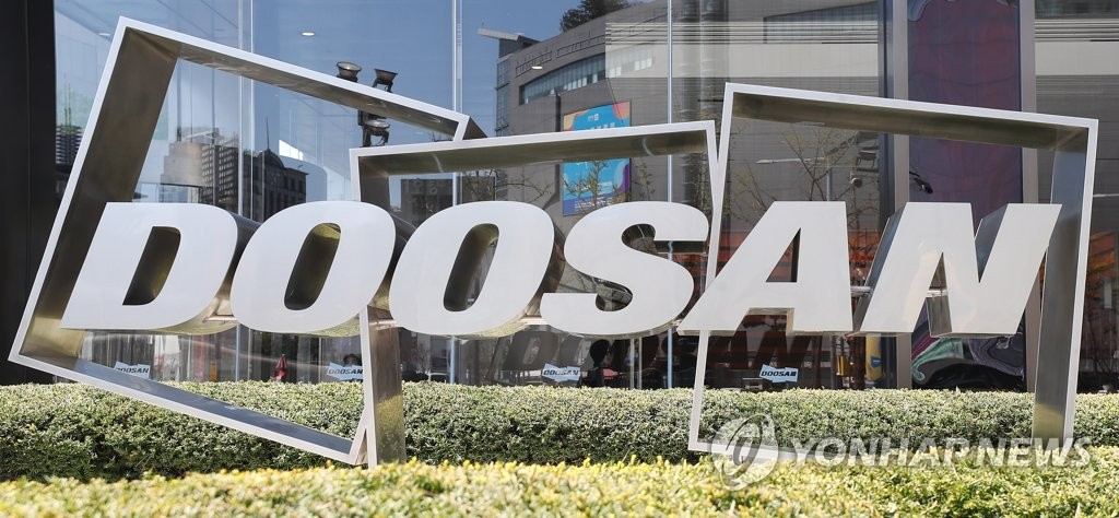 This file photo from April 8, 2020, shows Doosan Group's logo in front of Doosan Tower in Seoul. (Yonhap)