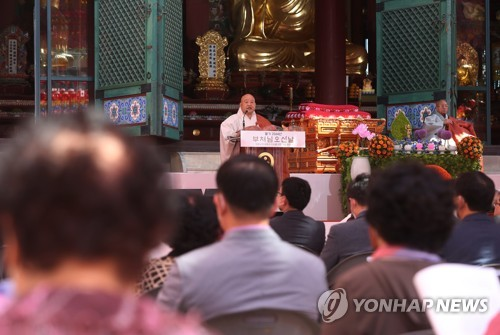 Leader speaks during Buddha's birthday event