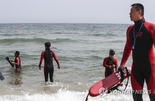 Lifeguards train before opening of Haeundae Beach