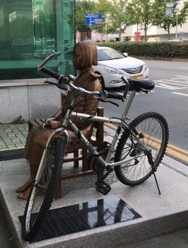 Bicycle chained to Statue of Peace