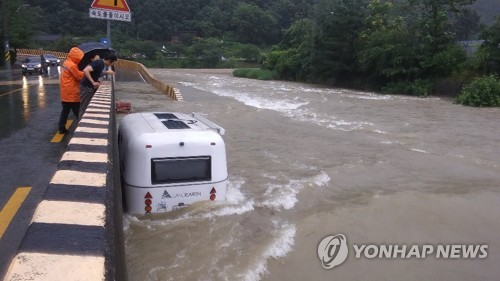 Camper trailer caught in flooded stream