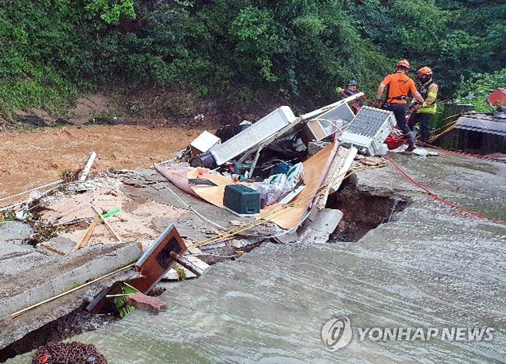 This photo, provided by fire authorities at North Chungcheong Province, shows rescue workers conducting a search near Eumseong after a 62-year-old was reported to have gone missing at a stream on Aug. 2, 2020. (PHOTO NOT FOR SALE) (Yonhap)