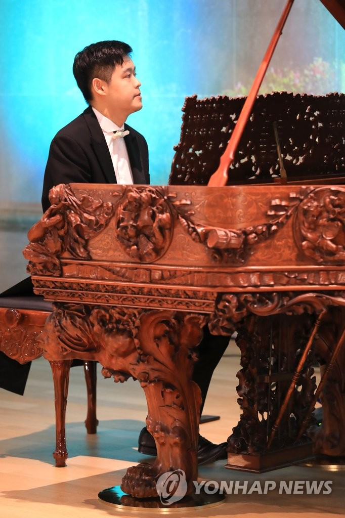 Piano carved by Auguste Rodin