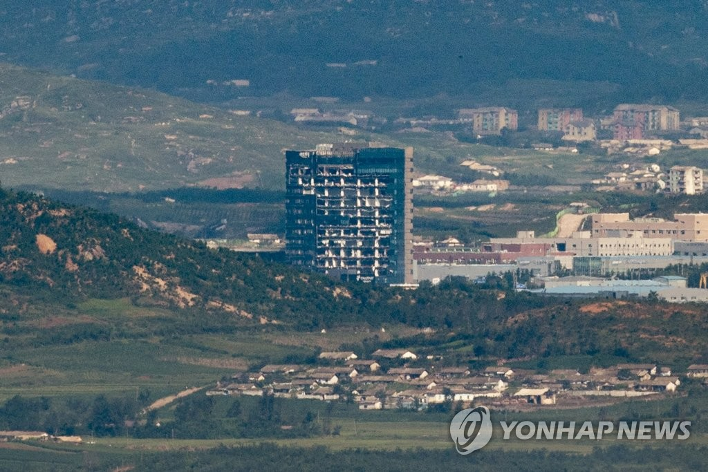 This file photo, taken from the South Korean border city of Paju on Sept. 8, 2020, shows the South Korea-built support center for the Kaesong Industrial Complex in the North Korean border town of Kaesong, which was severely damaged by the indirect impact of the North's destruction of the inter-Korean liaison office adjacent to the center in June of that year. North Korea marked the 72nd anniversary of the North Korean government's establishment the next day. (Yonhap)