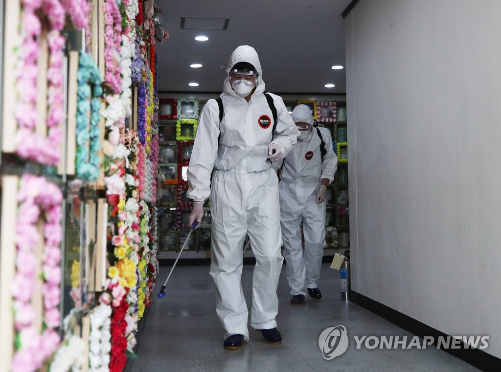 Workers disinfect a cemetery in Suwon, south of Seoul, on Sept. 22, 2020. (Yonhap)