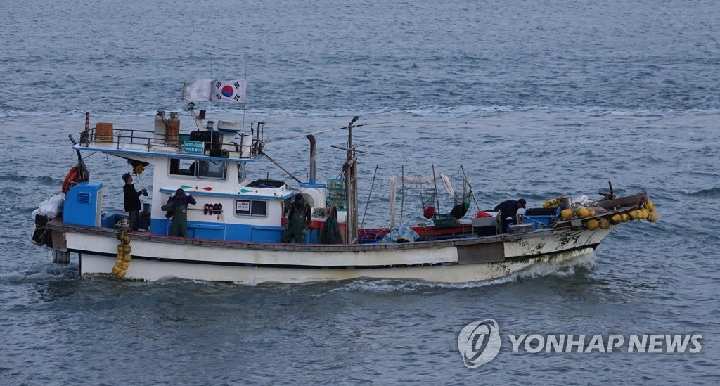 Fishing boat near sea border