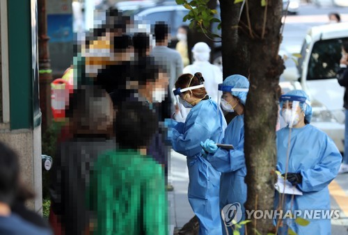 S. Korea to decide whether to further extend tougher virus curbs over weekend