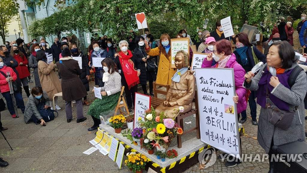 Activists stage a campaign calling for Mitte District to retract its order to remove a sex slave statue erected in a public park in Berlin, Germany, on Oct. 3, 2020. (Yonhap)