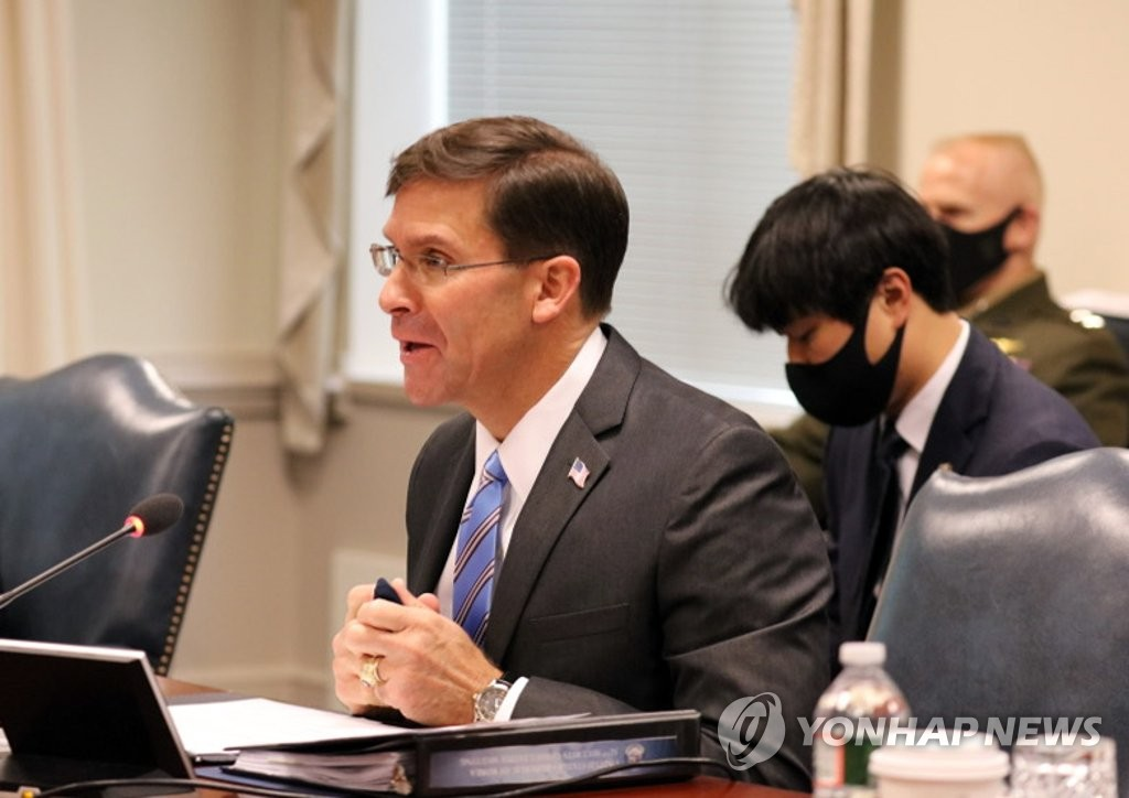 In the photo, taken Oct. 14, 2020, U.S. Secretary of Defense Mark Esper (L) is seen speaking in the annual defense ministerial talks, known as the Security Consultative Meeting, held with his South Korean counterpart, Suh Wook, in Washington. (Pool photo) (Yonhap)